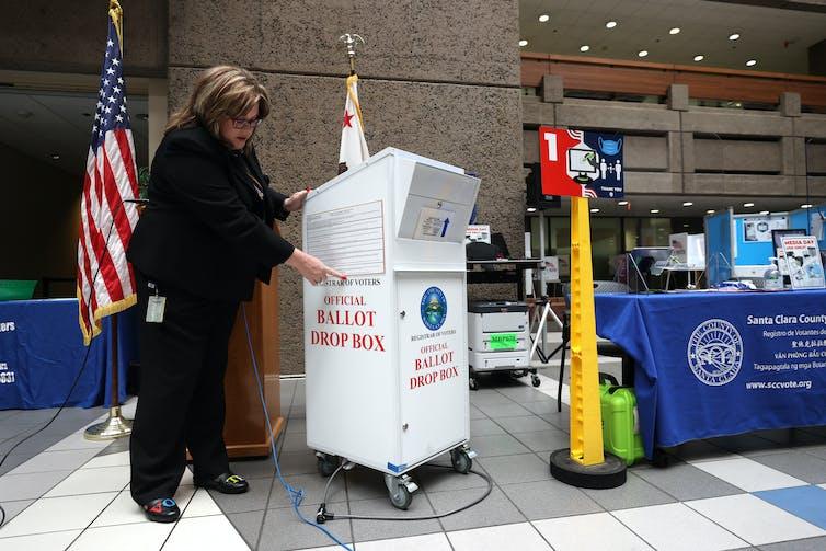 Santa Clara County Registrar of Voters' Shannon Bushey shows an official county ballot collection box