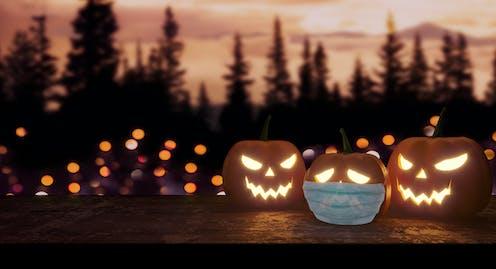 Jack-o-lanterns, one with a face mask.