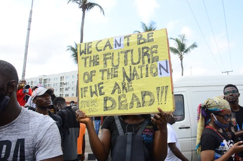 A protestor displays a placard at one of the EndSARS protests