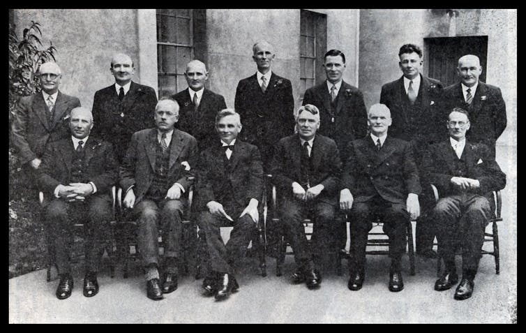 men from the 1930s seated and standing
