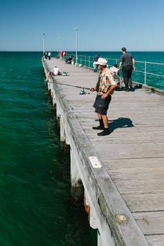 A man fishes in Melbourne.