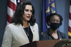 Michigan Gov. Gretchen Whitmer is seen speaking at a podium.