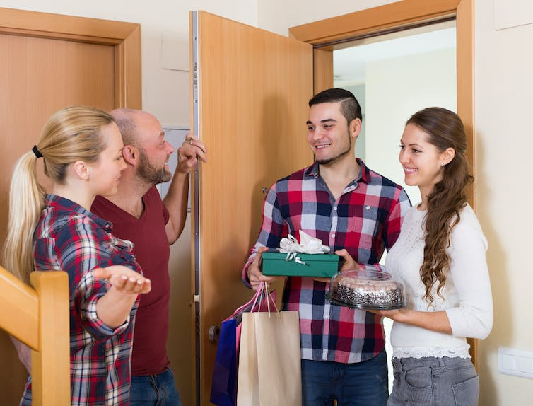 Four people gathering indoors