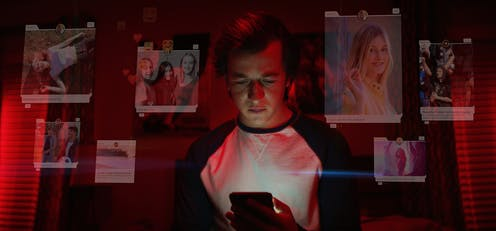A young man looks at his mobile phone, the screen lighting his face. Around him are graphics showing photos from social media of beautiful young women and messages of fun and friendship.