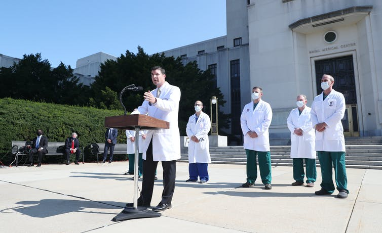 Doctors briefing the media on President Trump's health outside the Walter Reed Medical Center