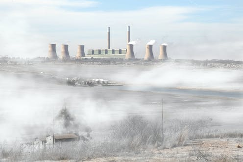 A coal plant emitting smoke into the environment.