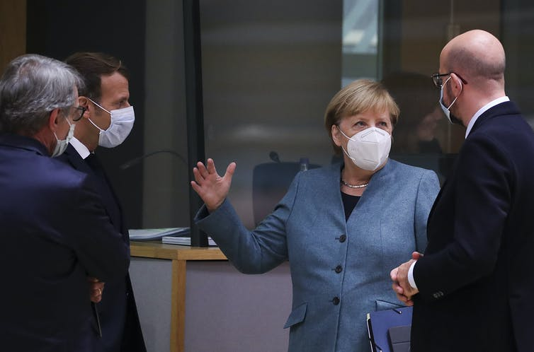 European leaders chat while wearing covid masks.