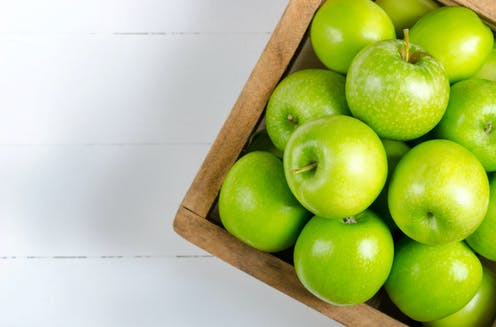 A box of green apples.