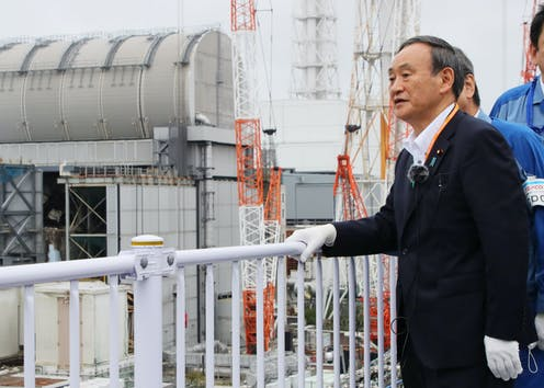 Japan's Prime Minister inspects a water tank in Fukushima