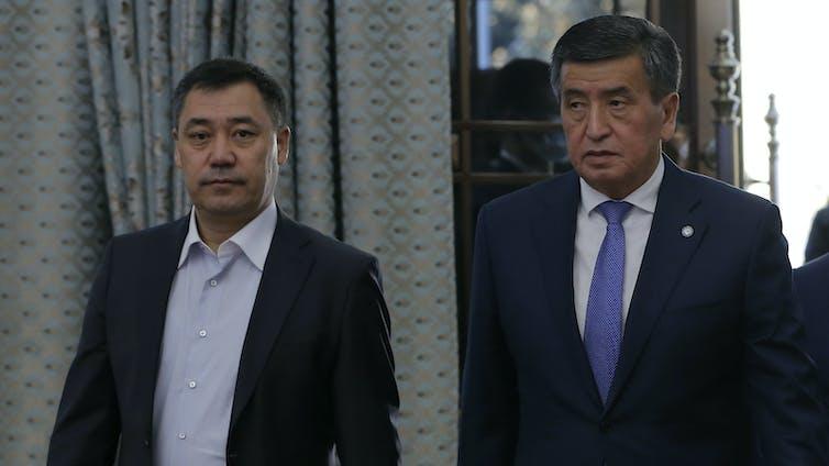 Kyrgystan's new president Sadyr Japarov, standing with the president he ousted, Sooronbay Jeenbekov