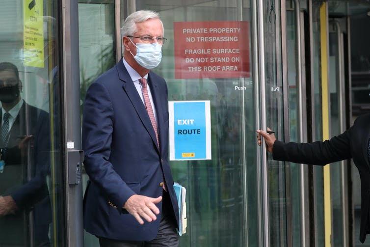 Brexit negotiator Michel Barnier wearing a mask.
