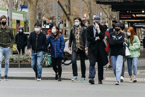 People donning masks in Melbourne, Australia