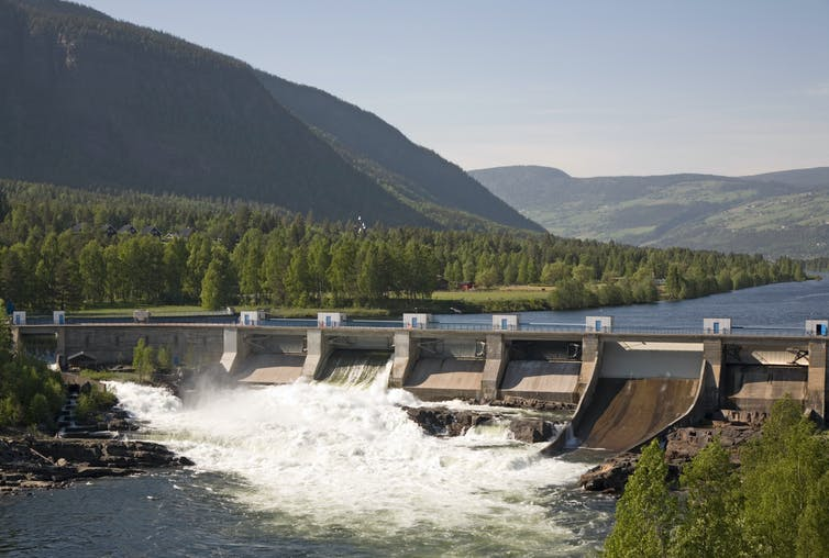 Dam and reservoir in a large forested valley