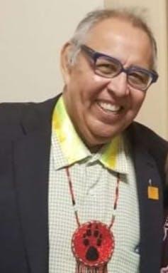 A man smiling.