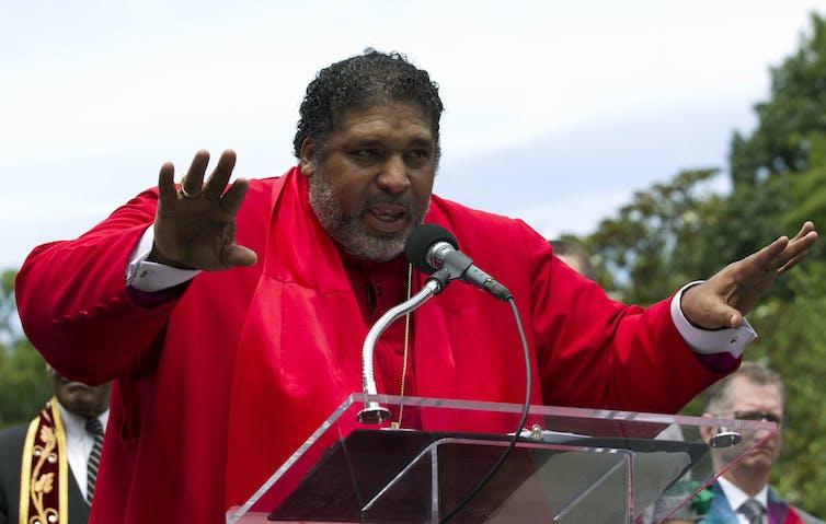 A man in preacher's robes.