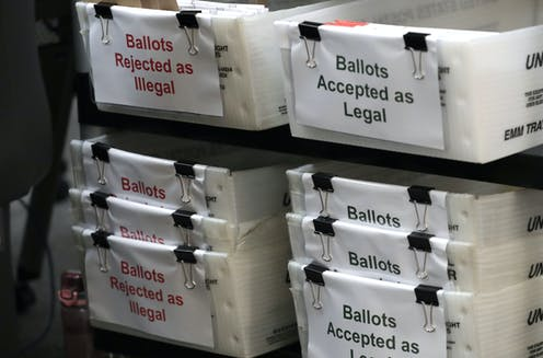 Florida ballots are placed in boxes labeled 'Rejected as Illegal' and 'Accepted as Legal'