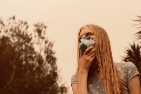 Teenage girl wearing face mask