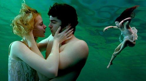 Movie still: two people kiss underwater