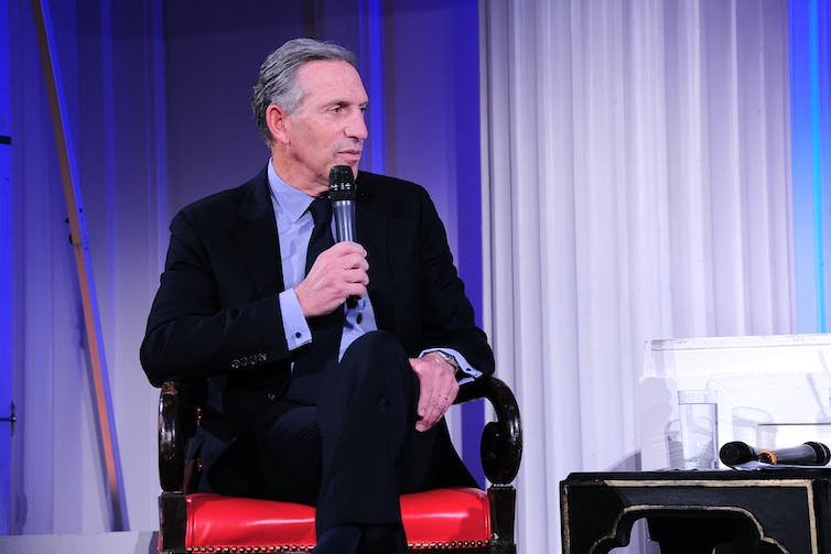 Howard Schultz speaks at a panel discussion.