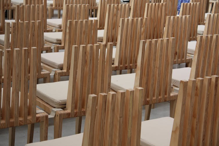 Rows of modern wooden chairs.
