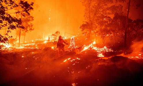 A firefighter fighting flames in California.