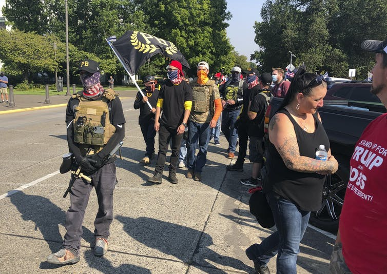 Members of the Proud Boys arrive at an event in Oregon.