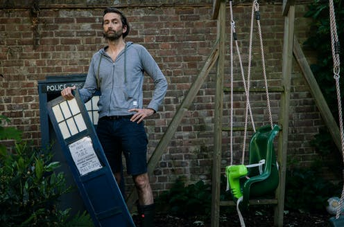 Actor David Tennant with a model of Doctor Who's Tardis in his garden.