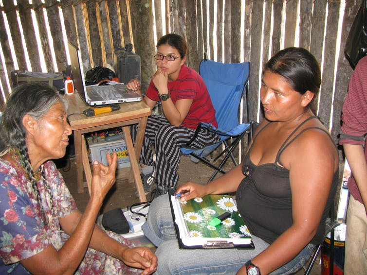 medical workers interview a Tsimane woman