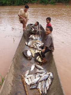 Tsimane man and boys after fishing.