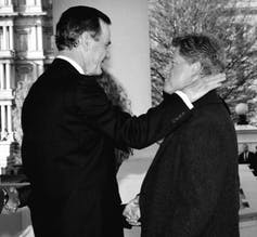 George H.W. Bush greets Bill Clinton