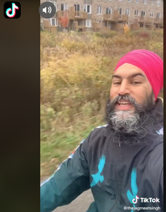 Singh wears a fuschia turban while singing in a TikTok video.