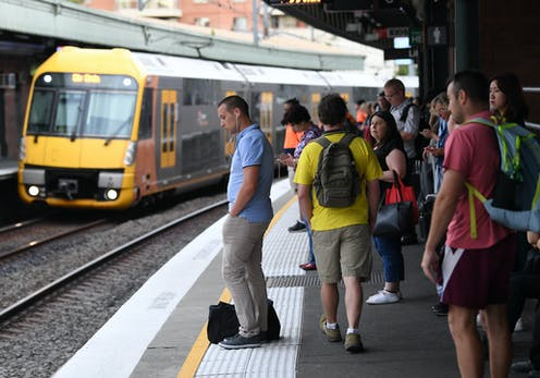 Commuters waiting on platform for a train
