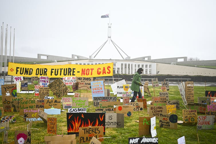 Protest signs outside Parliament House in Canberra