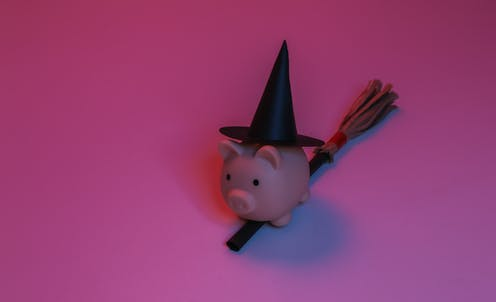 Piggy bank wearing a witches hat.