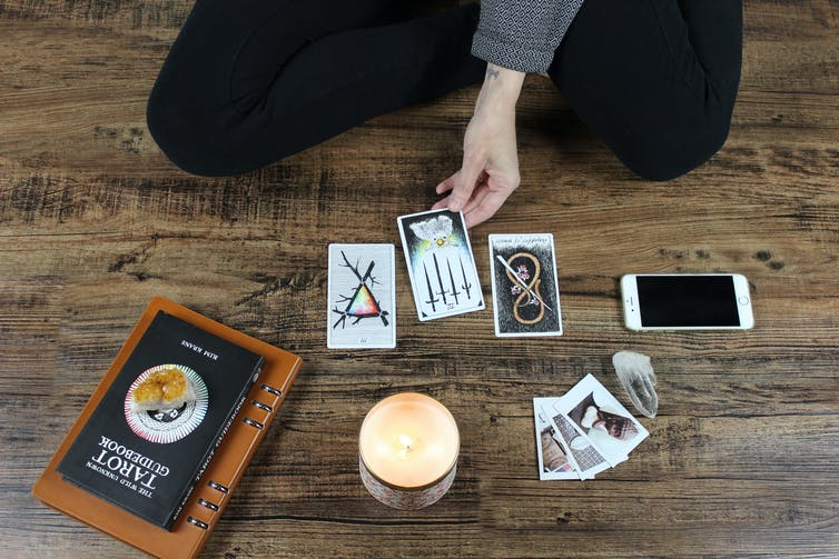 Woman reading tarot.