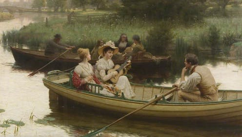 A woman serenades a female and male companion in a row boat.