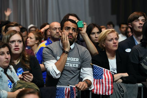 Sad people at a Hillary Clinton election party in 2016.