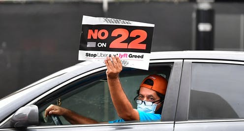 An app-based driver protests in a car caravan in Los Angeles on Oct. 22.