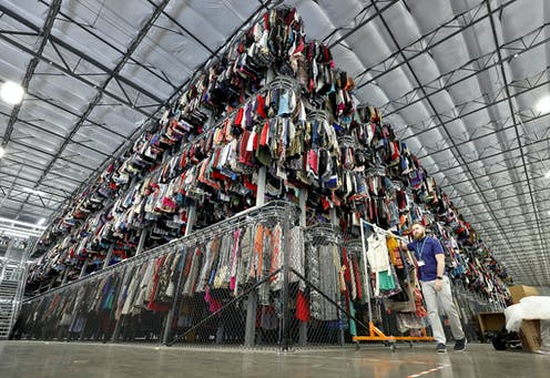 Thousands of garments are stored on a three-tiered conveyor system.