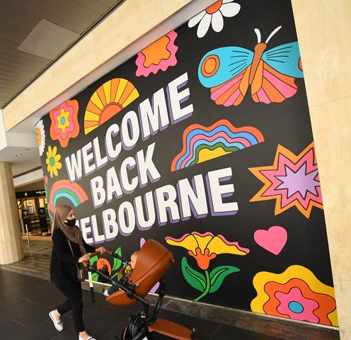 A mural reading Welcome Back Melbourne