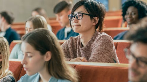 Students listening in lecture hall