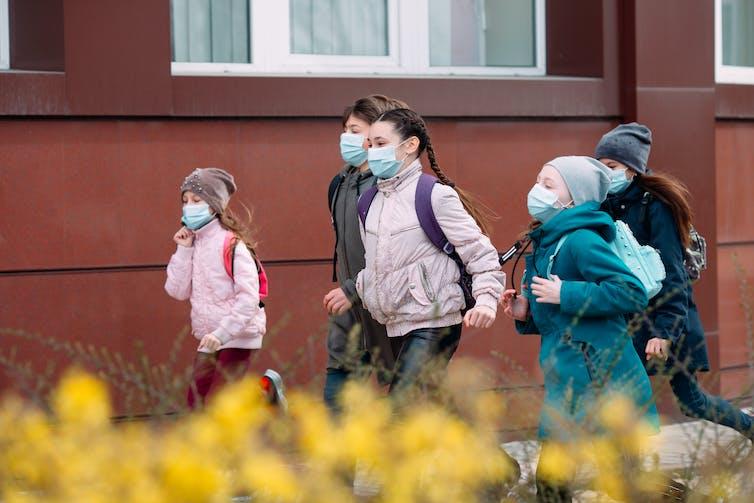 Children in masks leaving school