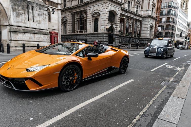 A Lamborghini sports car driving through London