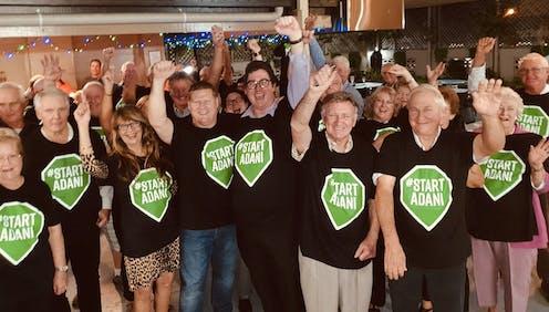 Queenslanders cheering in support of the Adani mine