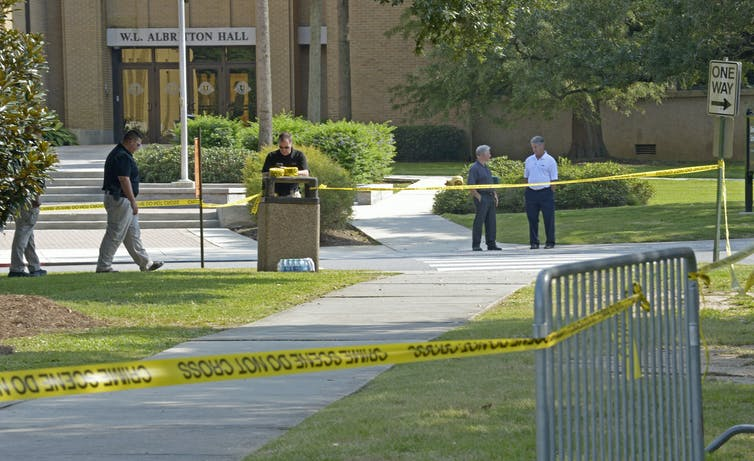 Police tape around a university college building