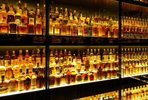Rows of specialist whiskies on a gantry.