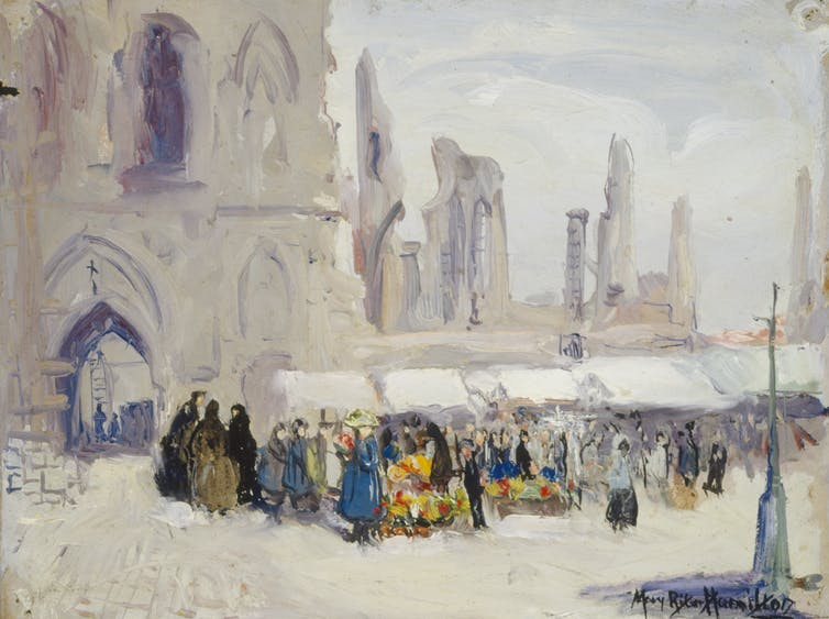 A market crowd in front of a church.