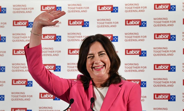 Queensland Premier Annastacia Palaszczuk waving, claiming victory