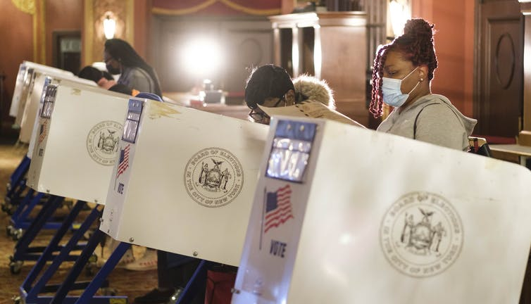 People casting early ballots in New York for the US election, October 2020.