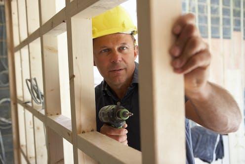 Man building timber frame